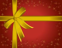 Present Ribbon. Beautiful red paper and golden ribbon present Royalty Free Stock Photography