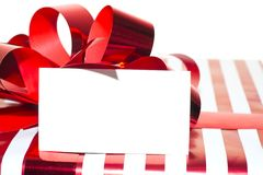 Present with Ribbon and tag. Isolated on white Royalty Free Stock Images