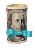 Present of roll of dollars with blue ribbon. Bow isolated on white background stock images