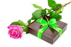 Present and rose Royalty Free Stock Image