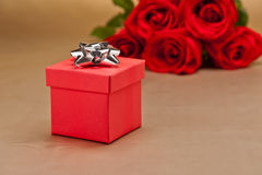 Present  and roses Stock Photography