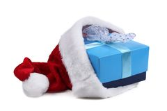 Present in Santa Claus hat Royalty Free Stock Image