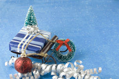 Present on sleigh with ornaments Royalty Free Stock Photo