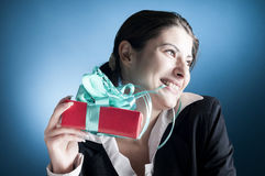 Present with a special ocasion. Business woman looking happy with a beautiful box as a present received with a special ocassion Stock Photography
