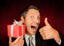 Present surprise. Portrait of business male with present gift Stock Photo