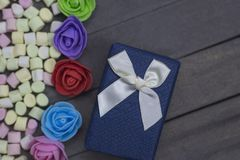 Present, surprise, love concepts. gift box. Marshmallow candies with flower buds. Present, surprise, love concepts. gift box. Marshmallow candies with flower stock photo