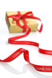 Present with Valentine's ribbon Stock Images