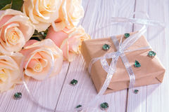 Present for Valentines day with roses Stock Photos