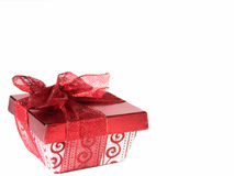 Present on White. Red and white gift box with red lace ribbon on white background. Copy space stock images