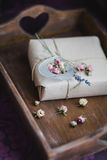 Present wrapped in eco craft brown paper on a wood Royalty Free Stock Image