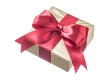 Present wrapped in glittery paper with red ribbon isolated on wh Stock Image