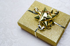 A Present Wrapped in Gold Box Royalty Free Stock Images