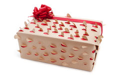 Present wrapped with kraft paper with heart-shaped holes Stock Photos