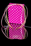 Present wrapped with poky dots and ribbon Royalty Free Stock Photo