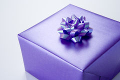 Present Wrapped In Purple Paper Stock Photography