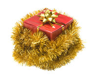 Present wrapped in tinsel Royalty Free Stock Photo