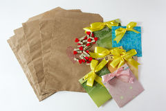 Present wrapper. With craft paper envelope, small clothepins and cute handmade envelopes on the white background Royalty Free Stock Photography