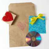 Present wrapper. For laser disk with craft paper envelope and cute handmade envelope on the white background Stock Images