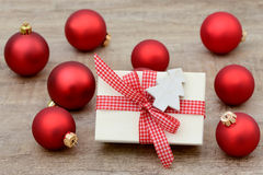 Present and xmas balls Stock Image