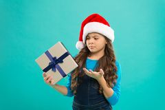 Present for Xmas. Childhood. New year party. Santa claus kid. Christmas shopping. Happy winter holidays. Small sad girl. Little girl child in santa hat stock photo
