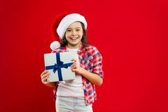 Present for Xmas. Childhood. New year party. Santa kid. Christmas shopping. Happy winter holidays. Small girl. Little. Girl child in santa hat. Christmas royalty free stock photography