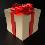 A Present For You. A gilt gift box with metallized red ribbon on black background. Computer generated image with clipping path Royalty Free Stock Photo