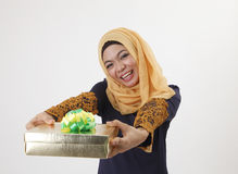 Present for you. Malay woman with tudung giving a present away Stock Photography