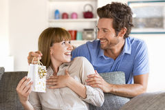 Present for you my love. Gift, sofa, home, girlfriend, couple Royalty Free Stock Images