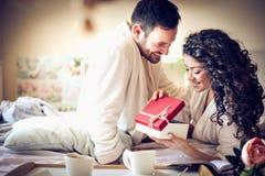 Present for you. Valentines day. Boyfriend giving present to his girlfriend. Valentines day. Happy couple Stock Photo