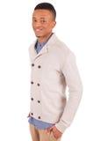 Presentación africana joven casual del hombre Imagen de archivo libre de regalías