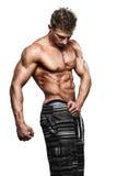Presentación atractiva hermosa muscular del individuo Fotografía de archivo libre de regalías