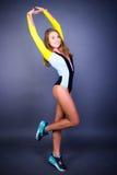 Presentación de la muchacha del deporte de la sonrisa Foto de archivo