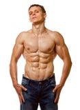 Presentación descubierta mojada atractiva del hombre joven del músculo Imagen de archivo libre de regalías