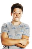 Presentación emocional del hombre hermoso joven de Brunete en el fondo blanco Foto de archivo libre de regalías
