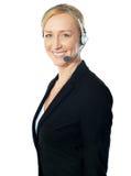 Presentación excutive del centro de llamada con los receptores de cabeza Foto de archivo libre de regalías