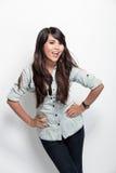 Presentación feliz de la mujer joven Imagen de archivo libre de regalías