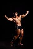 Presentación joven del bodybuilder Imagen de archivo
