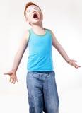 Presentación joven en cuestión gritadora del muchacho del Redhead Imagen de archivo