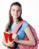 Presentación linda joven del adolescente alegre contra el fondo blanco Fotografía de archivo libre de regalías