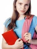 Presentación linda joven del adolescente alegre contra el fondo blanco con los libros y la mochila Foto de archivo libre de regalías