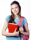 Presentación linda joven del adolescente alegre contra el fondo blanco con los libros y la mochila Foto de archivo
