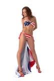 Presentación modelo hermosa en bikini estrella-rayado Foto de archivo libre de regalías
