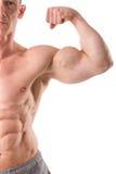 Presentación muscular apta del hombre Fotografía de archivo libre de regalías