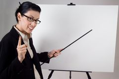 Presentation. Female presenter with blank presentation whiteboard Stock Image
