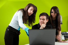 Presentation. Group of three young people in the office Royalty Free Stock Photos