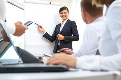 Presentation. Image of businesswoman doing presentation to businesspeople during conference Stock Photo