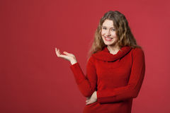 Presentation. Young woman makes a gesture of presenting Royalty Free Stock Images