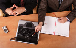 Presentation - 2 men working at the desk in the office Royalty Free Stock Photo