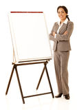 Presentation. Hispanic business woman wearing business suite standing nest to a presentation easel isolated on white stock photo