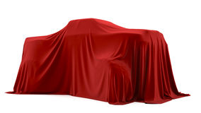 Presentation of the big car. Autoshow. Car under the tissue Stock Image